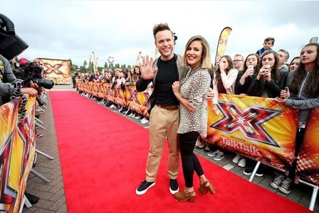 Olly Murs and Caroline Flack arrive for the X Factor Live Auditions, Event City, Manchester. PRESS ASSOCIATION Photo. Picture date: Wednesday July 8, 2015. Photo credit should read: Peter Byrne/PA Wire